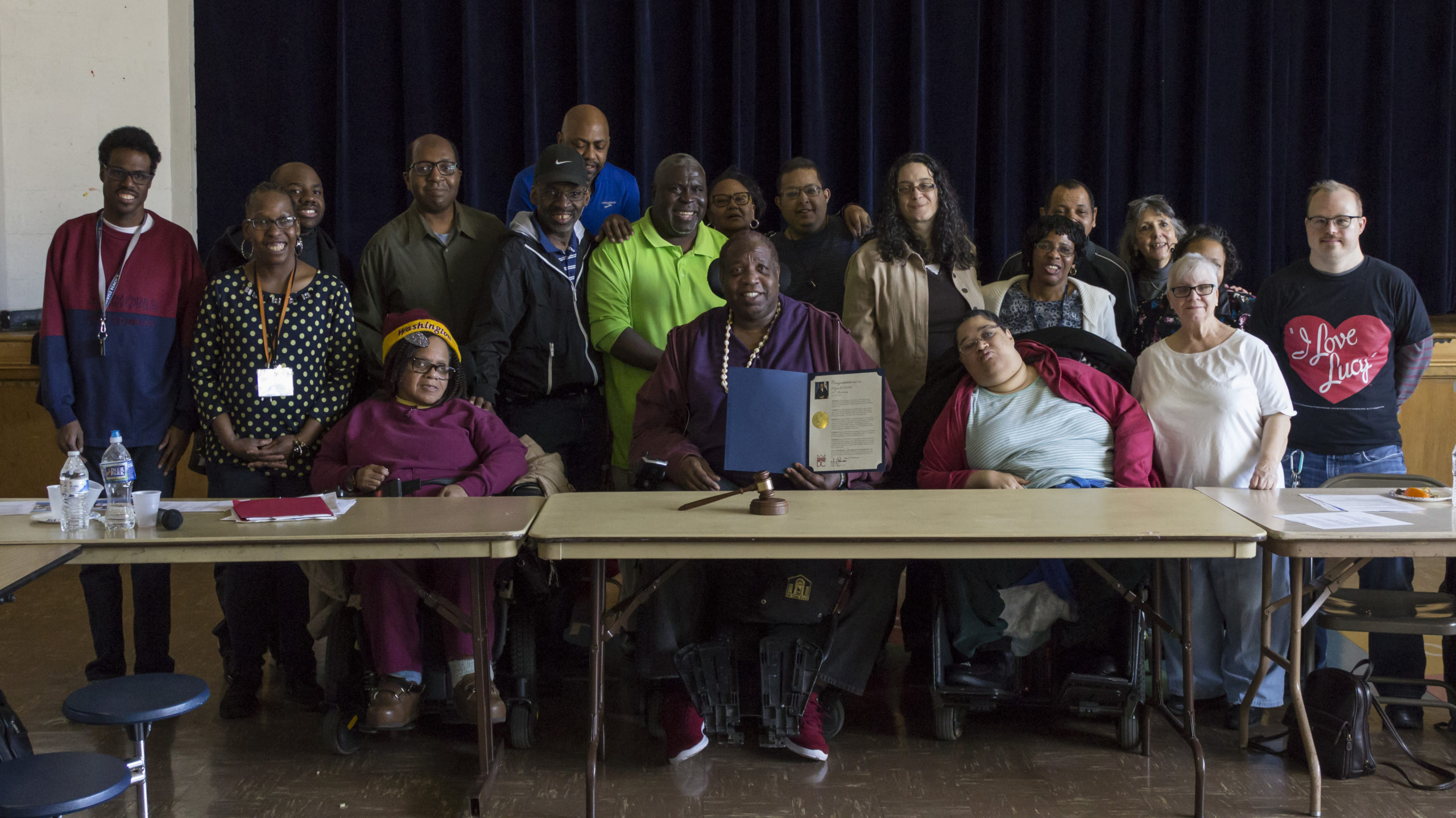 Group picture of Self Advocates smiling with Proclamation