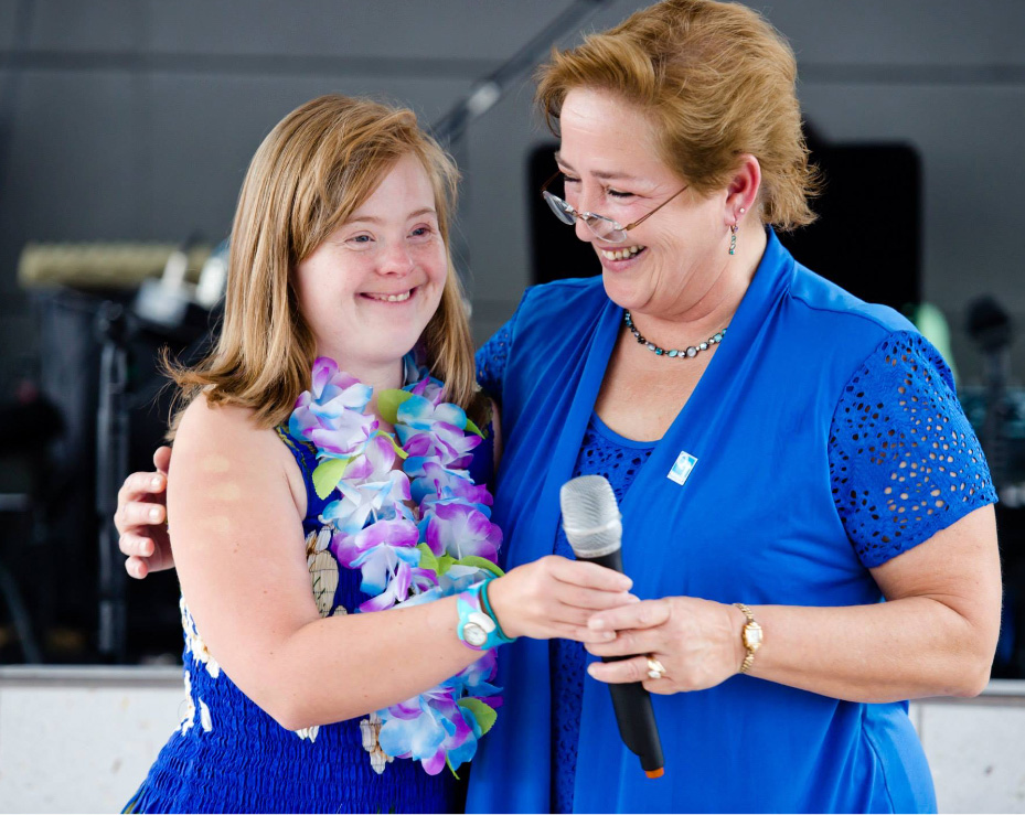 woman standing with girl who has downs syndrome